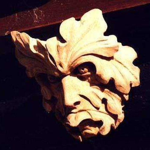 Green Man with tongue. Oak H 7in
